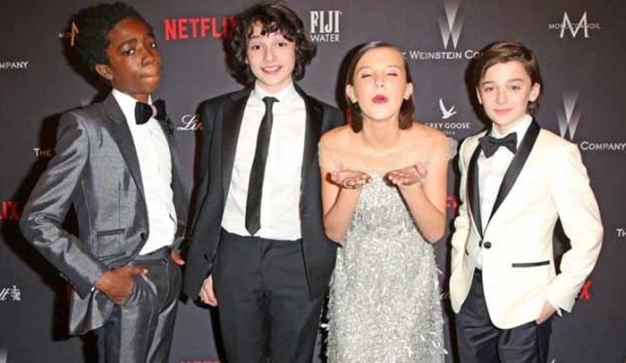 Mandatory Credit: Photo by Brian To/Variety/REX/Shutterstock (7734804b) Caleb McLaughlin, Finn Wolfhard, Millie Bobby Brown, Noah Schnapp The Weinstein Company and Netflix Golden Globes After Party, Arrivals, Los Angeles, USA - 08 Jan 2017