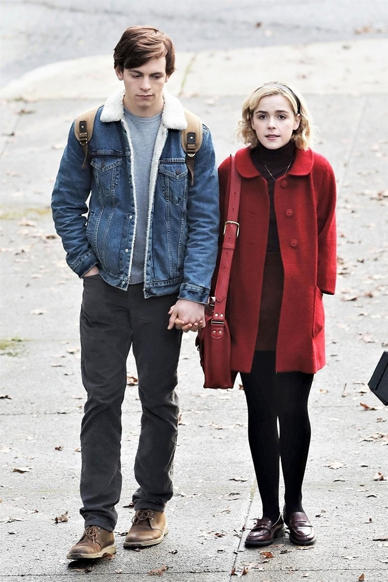 Vancouver, CANADA  - *EXCLUSIVE*  - First look on the set of 'Sabrina the Teenage Witch' played by Kiernan Shipka from 'Mad Men' and her on-screen love interest played by Ross Lynch. The two strolled hand-in-hand on the set in Vancouver.  Pictured: Kiernan Shipka, Ross Lynch  BACKGRID USA 4 APRIL 2018   BYLINE MUST READ: JKING / BACKGRID  USA: +1 310 798 9111 / usasales@backgrid.com  UK: +44 208 344 2007 / uksales@backgrid.com  *UK Clients - Pictures Containing Children Please Pixelate Face Prior To Publication*